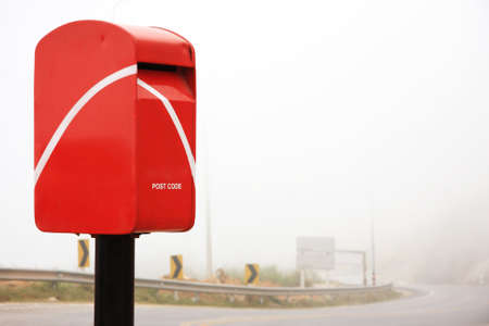 Postbox beside the road in countryside photo
