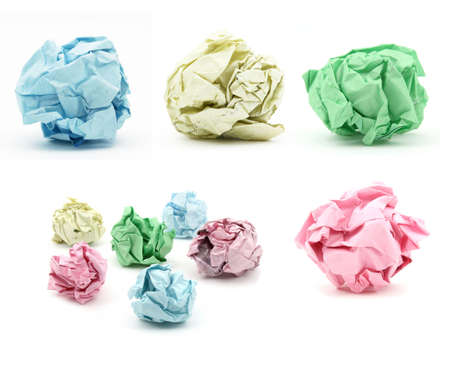 Bunch of cumbled color paper on white backgound