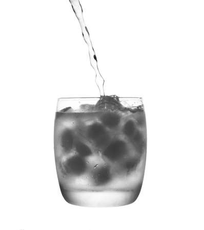 Glass with ice and pouring water