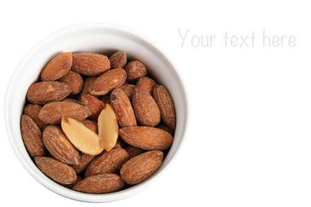 Almonds with salt on white background Stock Photo