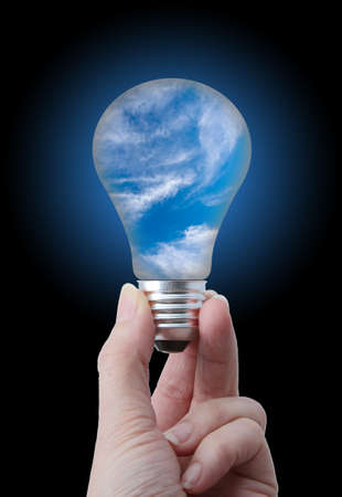 Clean air concept  Lightbulb with sky and white cloud inside Stock Photo - 13360692