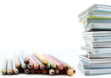 Composition of stack of books and color pencils for education concept Stock Photo
