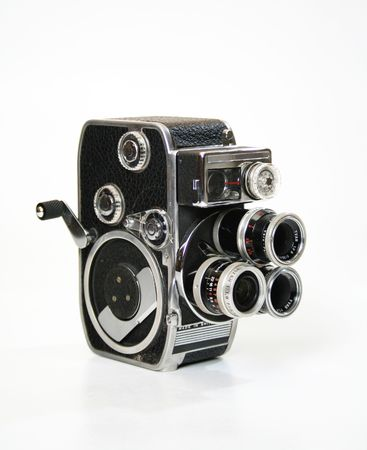 cine: Old 8mm cine film camera with turrent and crank.