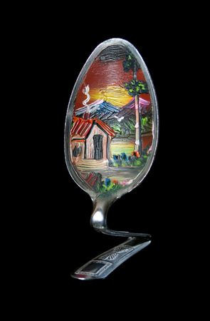 A bent spoon craft with oil painting of rural landscape.