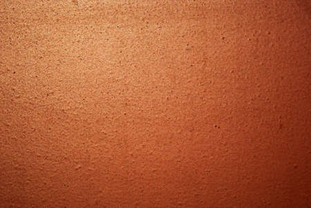 sheen: Iron rusty wall painted with red paint. The texture with a slight sheen of the sun.