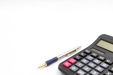 Calculator and pen isolated on white background. The machine is made of plastic. There is a numeric keypad. Used to calculate mathematics or financial accounting. And use a pen to take notes