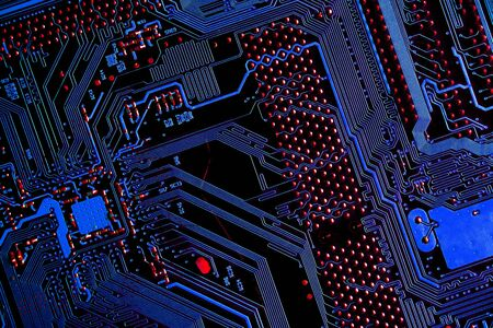Circuit board of computer motherboard, concept background Computer technology with blue and red colors, for use as a backdrop for presentations. Information Engineering Components and technology. Stock fotó