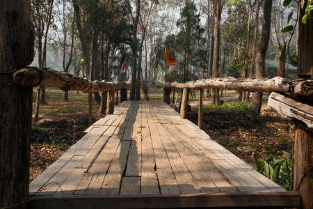 retreats: View of Wooden Bridge in Park in Buddhist monastery Wat Tam Wua, Nothern Thailand.