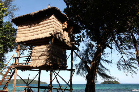 ron: Reed House on poles in the beach in Koh Ron island in Cambodia just 10 meters from the sea Editorial