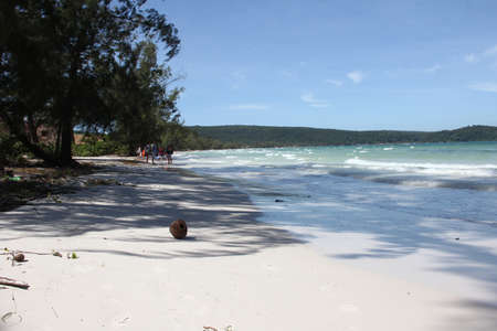 ron: Serenity beach with white sand, waves and trees on far tropical island Koh Ron in Cambodia. Stock Photo