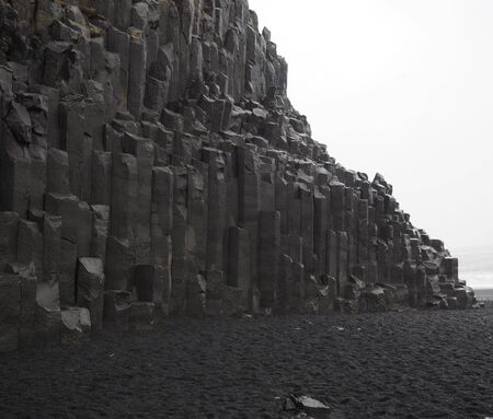 laborers: Basalt Columns on Sea Coast in Iceland