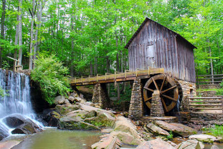 Vintage water mill with water wheel that show running water. Unfortunately, the mill is not funcioning anymore, but is used for wedding photo shoots and other aniversaries