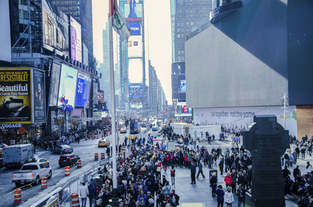 adverts: Times Square, New York,USA - November 23rd 2014 :- A busy Times Square New york. Picture shows crowds of unidentified people going about their business. Various billboard adverts can also be seen.