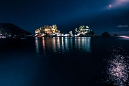 Panagias Island At Night In Parga Greece. The small church on Panagias Island in Parga lights up the night.