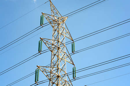 sub station: Power transmission lines against blue sky Stock Photo