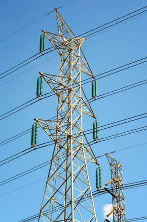 hz: Power transmission lines against blue sky Stock Photo