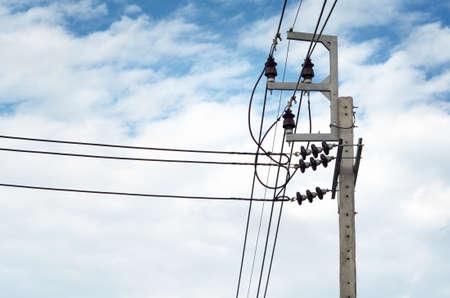 sub station: Power transmission lines  22 kV System  against blue sky