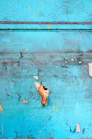 Blue rusty steel door with paint damage photo
