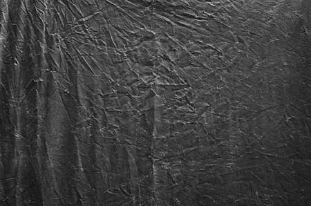 Black plastic sheet texture background photo