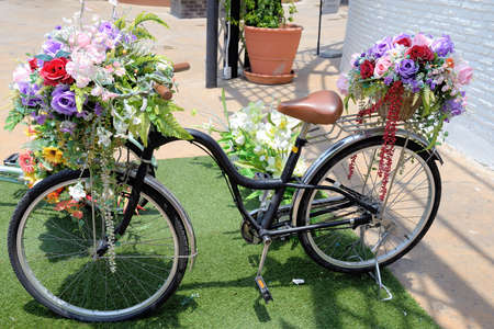 Bicycle with flower on basket  Bicycle with flower Stock Photo