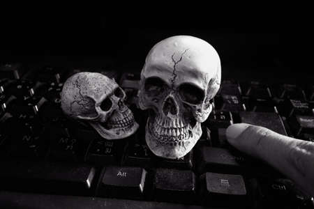 Skull human model on keyboard
