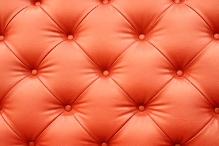 Red leather sofa texture background