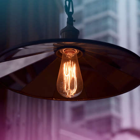 Retro style incandescent light bulb Stock Photo