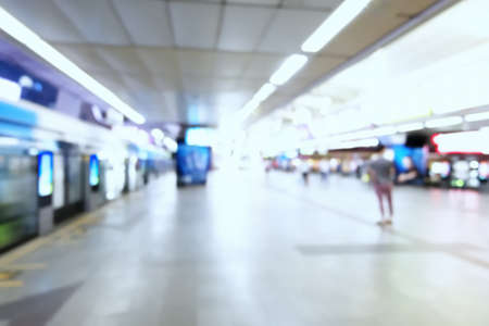 Blurred of People Walking in the skytrain station