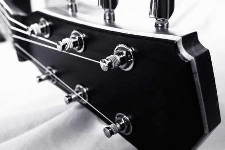 Black and white closeup of classic guitar