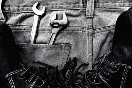 Black and white  jeans with Wrenches Stockfoto