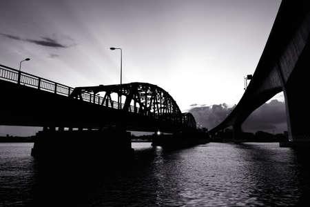 Black and White bridge across a Chao Phraya river Stock Photo