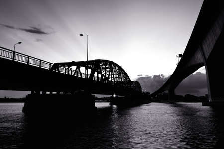 Black and White bridge across a Chao Phraya river Stockfoto