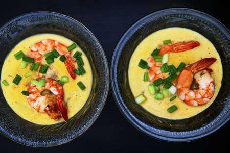 Steamed egg with Shrimp on black background