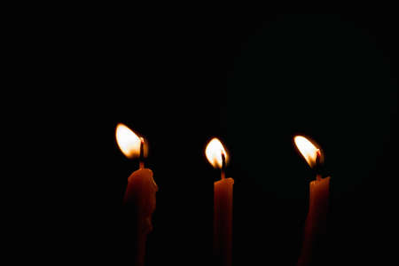 Group of Candles light on black background Stock Photo