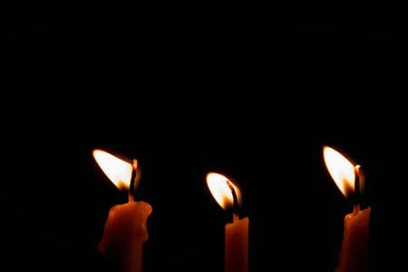 Group of Candles light on black background Stock Photo - 69445059