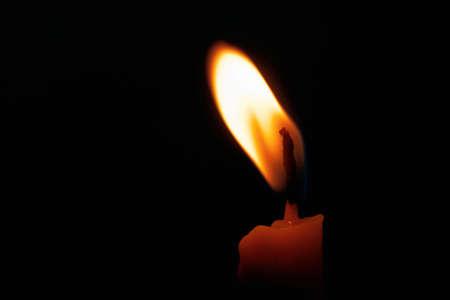 One Candle light on black background Stock Photo