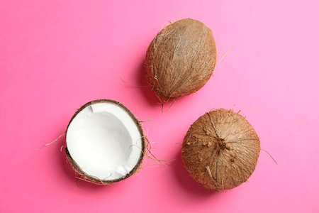 Tropical coconuts on color background, space for text