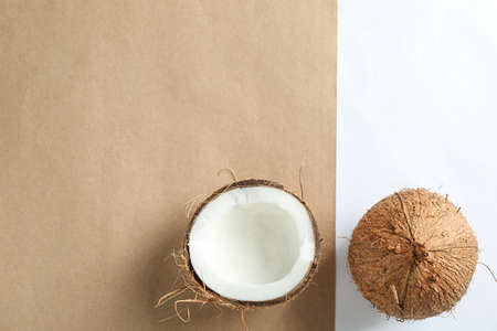 Tropical coconuts on two tone background, space for text Stock Photo