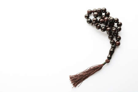 Prayer beads on white background, space for text