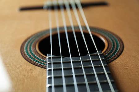 Beautiful six - string classic guitar as background, closeup