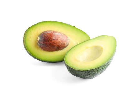 Ripe cut avocado isolated on white background. Vegetarian food