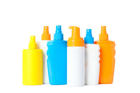Many different sunscreen sprays isolated on white background. Summer vacation accessories