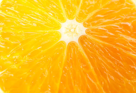 Fresh slice orange as background, space for text and closeup. Fresh citrus fruit