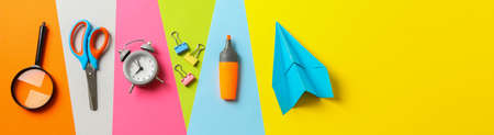 Flat lay composition with school supplies on multicolor background, space for text 写真素材