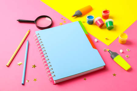 Composition with school supplies on two tone background, space for text 写真素材