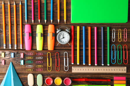 Flat lay composition with school supplies on wooden background 写真素材
