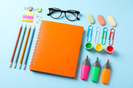 Flat lay composition with school supplies on color background, space for text
