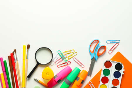 Flat lay composition with school supplies on white background, space for text