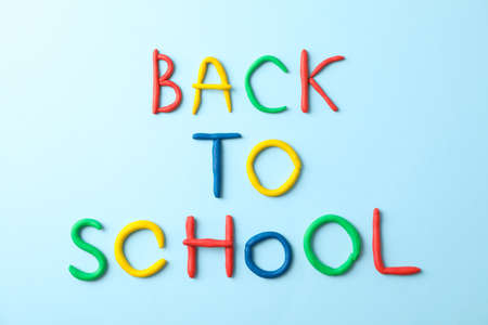 Inscription back to school on color background, space for text