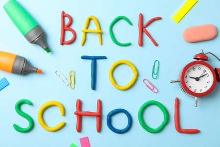 School supplies and inscription back to school on color background Stockfoto
